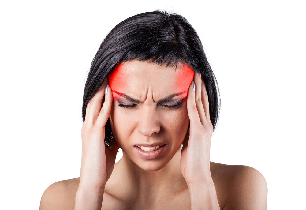Woman with pain points on head from migraine