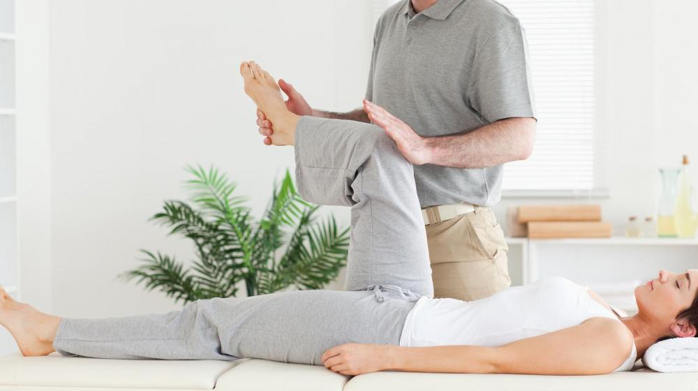 Woman getting adjustment from our Atlanta chiropractor, Dr. Simon