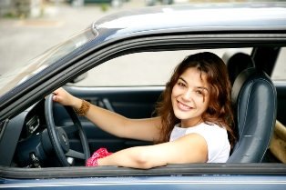 woman in car driving